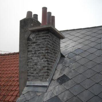 La cheminée rénovée par Delhez Toitures